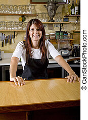 Waitress behind counter working in restaurant