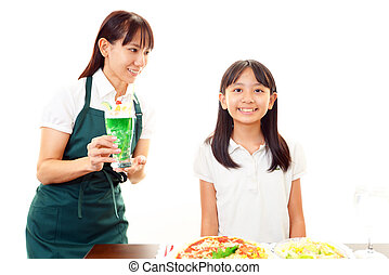 Waitress carrying a glass of juice