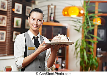 Waitress girl with cake on plate at restaurant - Young...