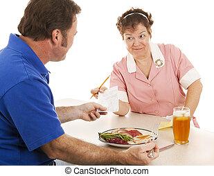 Waitress Hands Customer the Bill - Waitress in a diner hands...