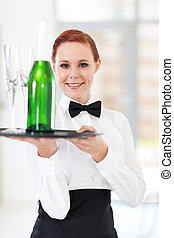 waitress holding a tray with champagne