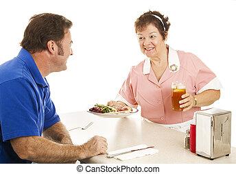 Waitress Serves Turkey Dinner - Waitress in a diner serving...