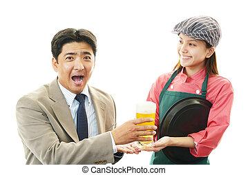 Waitress serving customer