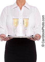 Waitress serving glasses of Champagne
