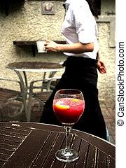 Waitress glides past wine glass