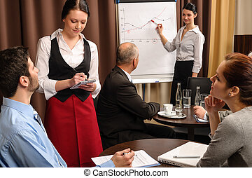 Waitress take order businesspeople conference room
