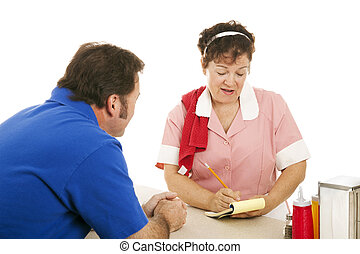Waitress Takes Customer Order - Waitress at a diner taking a...