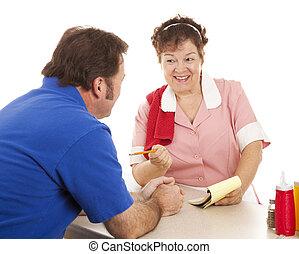 Waitress Takes Order - Friendly waitress taking a...