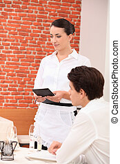 Waitress taking an order