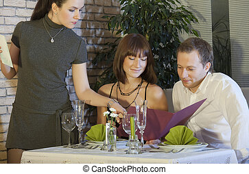 waitress taking order from couple