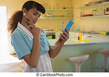 Waitress taking order in restaurant
