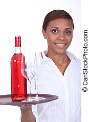 Waitress with a bottle of rose wine