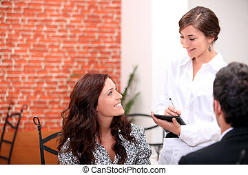Waitress with customers
