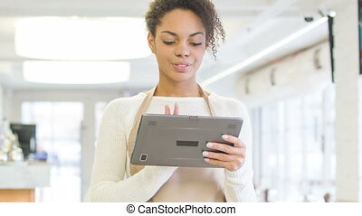 Waitress working with portable tablet. - Digital menu. Young...