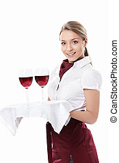 Waitress - Young waitress carrying a tray with glasses of...