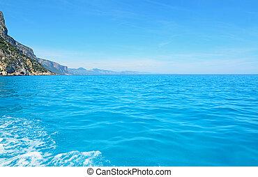 wake and sea - blue sea in Orosei Gulf, Sardinia
