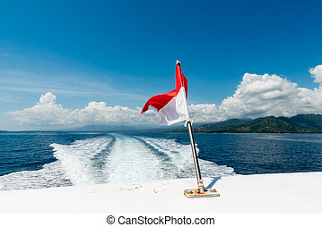 Wake of a speedboat on the ocean