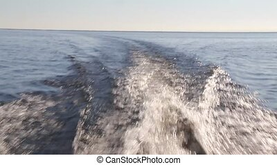 wake of fast moving motor boat