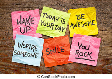 wake up, be awesome, inspire someone, smile, you rock - set of inspirational sticky notes against rustic wood