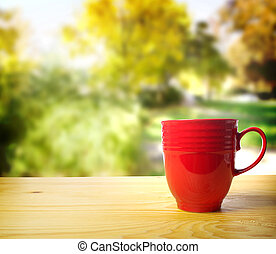 Wake up and Smell the Coffee - Red coffee mug overlooking a...
