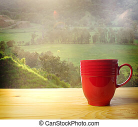 Wake up and Smell the Coffee - Red coffee mug overlooking a ...