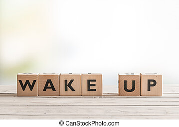 Wake up sign with wooden cubes