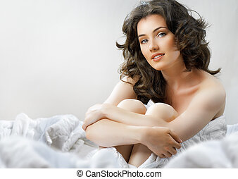 wake up - girl sitting on the bed