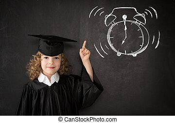 Wake up - Smart kid in class. Happy child against...