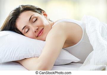wake up - beautiful girl sleeps in the bedroom