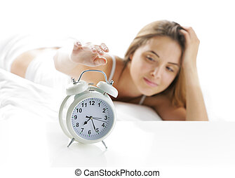 Wake up - Woman turning off the alarm clock