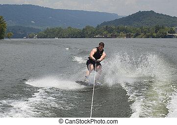 wakeboarder - man landing wakeboard jump