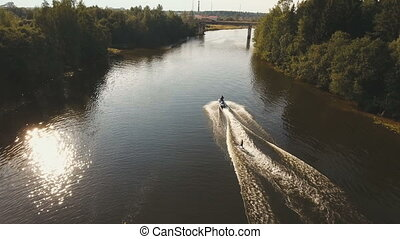 Wakeboarder surfing on the river.Aerial video. - Aerial:Wake...
