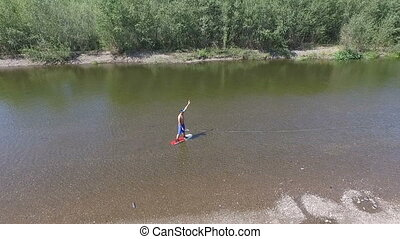 Wakeboarding on the river - An aerial view over the river,...