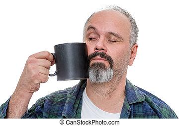 Waking man struggling to drink coffee
