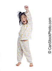 Waking up - A young child streching as she wakes up.