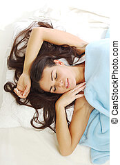 waking woman on the white pillow