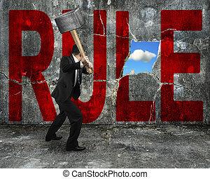 wal, mot, règle, frapper, béton, tenue, homme affaires, marteau, rouges