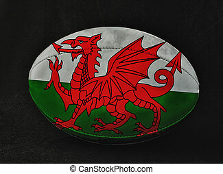 Wales rugby - Rugby ball with Wales flag colors, over black...