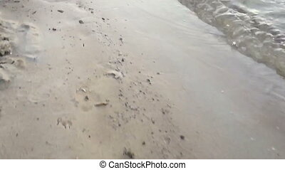 walk along the beach in slow motion