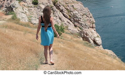 walk along the seashore - young woman walking along the...