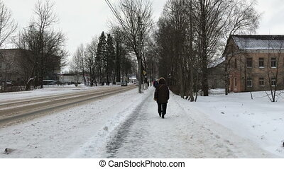 Walk down the street in winter. POV video
