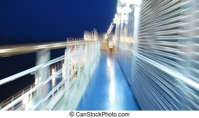 Walk in circles around the cruise liner at night, time lapse