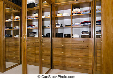 Walk in wardrobe - A walk in wardrobe inside a bedroom home.