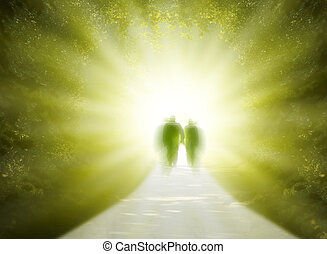 walk into light - Two people are walking into the light of...