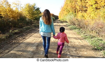 walk mother with a baby in nature