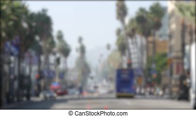 Walk of fame promenade, Los Angeles, Hollywood boulevard, California, USA. Pedastrians walking on on crossroad of streets. Entertainment and cinema industry iconic tourist landmark. Palms in LA city.