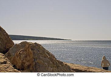 Walk on a rocky shore