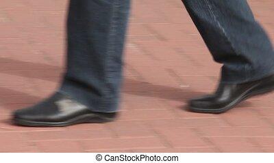 Walk on the pavement mature woman