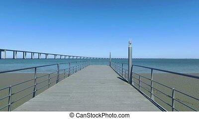 Walk on the Pier Near the Vasco da Gama Bridge in Lisbon,...