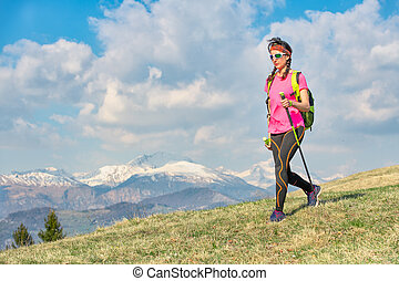 Walk on the spring mountain meadows with snowy mountains in the background